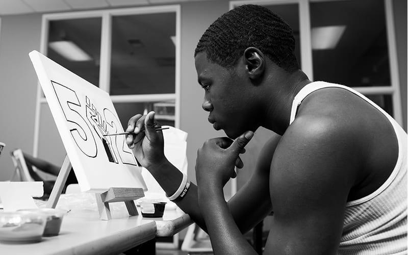 Man paints a 502 black lives matter sign